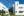 Vista de varias viviendas y zonas ajardinadas de la urbanización